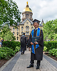 May 21, 2017; Graduate Michael Yu poses for a photo in front of the Main Building following Commencement 2017. (Photo by Matt Cashore/University of Notre Dame)