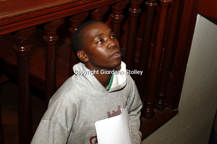 DURBAN - 30 January 2014 - Tshepang Solomon Mokhali, seen moments before he enters the dock at the Durban High Court. He is accused of murdering a tuck shop owner and her five children in their Inanda home in December 2012. Picture: Allied Picture Press/APP