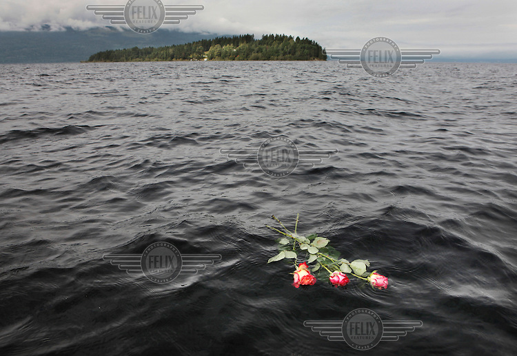 Flowers lie in the waters off Otoeya Island in memory of dozens of people killed on 22nd July 2011. A 32 year old man, Anders Behring Breivik, carried out a mass shooting attack on young people attending a political camp on the island which is about 40 Kilometres from Oslo.