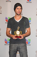 Enrique Iglesias in the pressroom at Univision's Premio Lo Nuestro a La Musica Latina at American Airlines Arena on February 16, 2012 in Miami, Florida. © mpi10/MediaPunch Inc