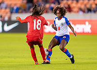 HOUSTON, TX - FEBRUARY 3: Keisilyn Gutierrez #18 of Panama collides with Dany Etienne #8 of Haiti during a game between Panama and Haiti at BBVA Stadium on February 3, 2020 in Houston, Texas.