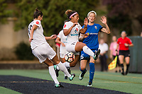 Seattle, WA - Sunday, September 24th, 2017: Desiree Scott, Megan Rapinoe, and Yael Averbuch during a regular season National Women's Soccer League (NWSL) match between the Seattle Reign FC and FC Kansas City at Memorial Stadium.