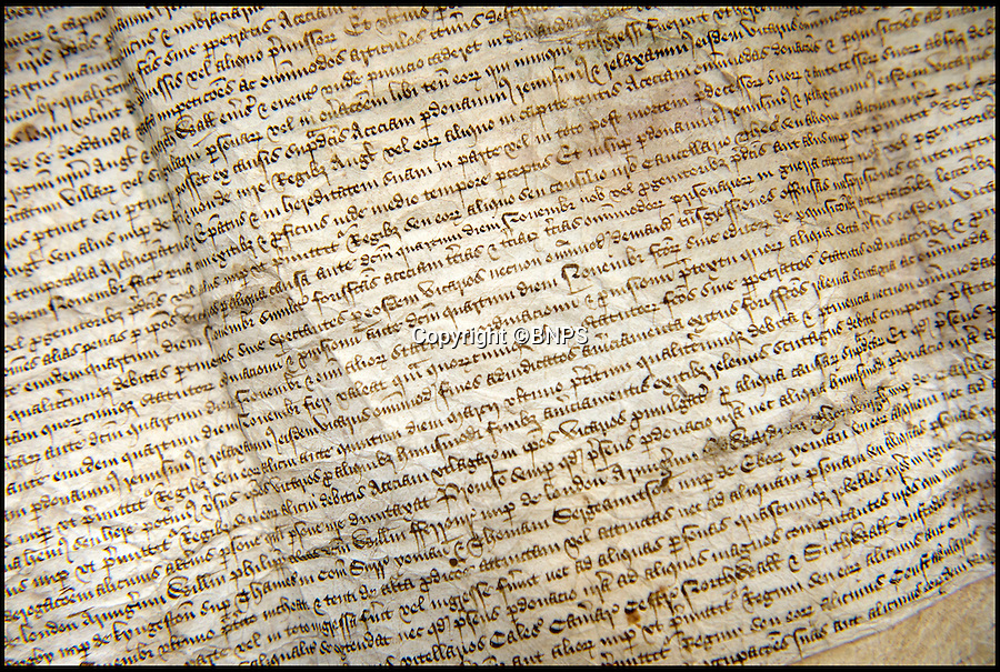BNPS.co.uk (01202 558833)<br /> Pic: PhilYeomans/BNPS<br /> <br /> Letter from King Edward IV in 1462 granting pardon to the Vicars Choral 'for whatever transgressions or offences which they may have committed'<br /> <br /> Latin scholar unearths ecclesiastical treasure's from the vault.<br /> <br /> Salisbury cathedral has recruited a new latin expert to decipher its precious collection of historic manuscripts which have remained unexamined for decades.<br /> <br /> Helen Sumping, 27, is working her way through thousands of documents that date back as far as 1136 at Salisbury Cathedral in Wiltshire, to uncover the secrets of the famous landmark.<br /> <br /> While some of the most important papers have had brief summaries written before, many of the documents have not been touched for centuries due to the difficulty of reading the handwritten script.<br /> <br /> The entire archive has not been worked on since the 1930s and Helen is now delving into the past to catalogue papers up to 880 years old and make the collection more accessible to the public.