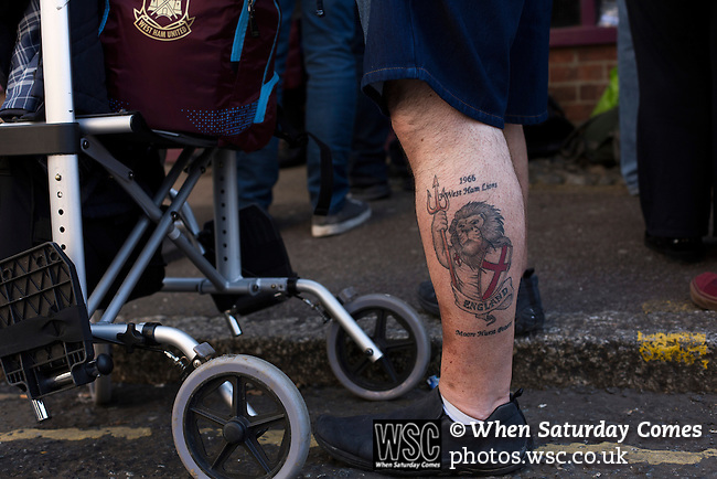 West Ham United 2 Crystal Palace 2, 02/04/2016. Boleyn Ground, Premier League. A man with an England tattoo on his leg, pictured near the Boleyn Ground before West Ham United hosted Crystal Palace in a Barclays Premier League match. The Boleyn Ground at Upton Park was the club's home ground from 1904 until the end of the 2015-16 season when they moved into the Olympic Stadium, built for the 2012 London games, at nearby Stratford. The match ended in a 2-2 draw, watched by a near-capacity crowd of 34,857. Photo by Colin McPherson.