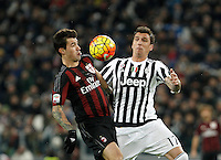 Calcio, Serie A: Juventus vs Milan. Torino, Juventus Stadium, 21 novembre 2015. <br /> AC Milan&rsquo;s Alessio Romagnoli, left, and Juventus&rsquo; Mario Mandzukic fight for the ball during the Italian Serie A football match between Juventus and AC Milan at Turin's Juventus stadium, 21 November 2015. Juventus won 1-0.<br /> UPDATE IMAGES PRESS/Isabella Bonotto