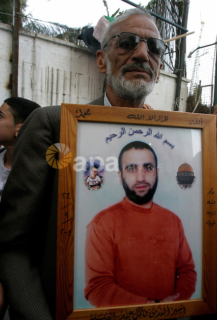 Palestinians hold portraits of relatives detained in Israeli prisons as they protest to demand for their release during a demonstration in support of Hanaa al-Shalabi outside Damascus gate, in the old city of Jerusalem, on March 24, 2012. Shalabi who was freed in a prisoner swap with Israel in October was taken to hospital on March 19 after being on hunger strike since her arrest in the northern West Bank on February 16, when she was originally ordered detained without trial for six months. Photo by Mahfouz Abu Turk