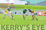 Kilmoyley's Joseph McElligott in possession as Kieran Dineen of Abbeydorney puts in a challenge in R2 of the Garvey Supervalu Hurling Championship on Sunday.