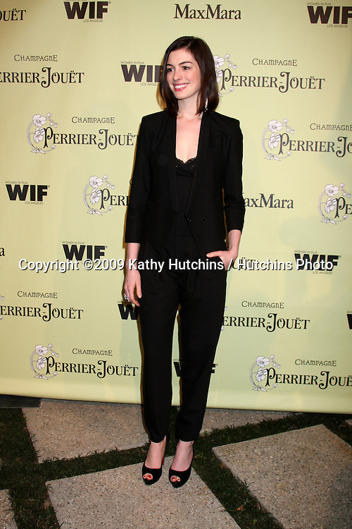 Anne Hathaway arriving at the Women In Film 2nd Annual Pre-Oscar Cocktail Party at the home of Peter & Tara Guber in Bel Air, CA on.February 20, 2009.©2009 Kathy Hutchins / Hutchins Photo...                .
