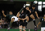 Rugby World Cup quarter finals. South Africa v New Zealand in Melbourne. South Africa's Ashwin Willemse (left) and All Black Mils Muliana clash during a race to get to the ball.