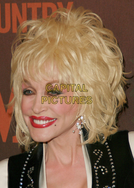 DOLLY PARTON.At CMT Giants honoring Reba McEntire held at the Kodak Theatre, Hollywood, LA, California, USA.26 October 2006..portrait headshot red lipstick.Ref: ADM/CH.www.capitalpictures.com.sales@capitalpictures.com.©Charles Harris/AdMedia/Capital Pictures.