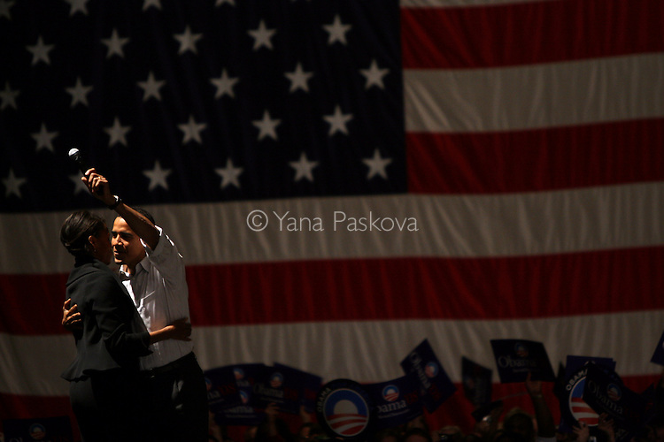 DES MOINES, IA - NOVEMBER 10:  Sen. Barack Obama (D-IL) hugs his wife, Michelle Obama, before he speaks to a full crowd prior to the Jefferson Jackson dinner on November 10, 2007, in Des Moines, IA. The dinner takes place in the Veterans Memorial Auditorium and is an Iowa caucus tradition. (Photo by Yana Paskova/Getty Images)
