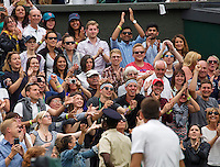 London, England, 01 July, 2016, Tennis, Wimbledon, Juan Martin Del Potro (ARG) throw his wristband in the crowd after defeating Stanislas Wawrinka (SUI)<br /> Photo: Henk Koster/tennisimages.com
