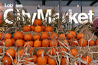 Fall pumpkin and bales of hay fall display outside a Loblaws City Market grocery store, Vancouver, BC, Canada