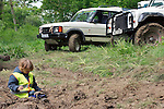 Child playing with his toy off-road truck during the ALRC National 2008 RTV Trial. The Association of Land Rover Clubs (ALRC) National Rallye is the biggest annual motor sport oriented Land Rover event and was hosted 2008 by the Midland Rover Owners Club at Eastnor Castle in Herefordshire, UK, 22 - 27 May 2008. --- No releases available. Automotive trademarks are the property of the trademark holder, authorization may be needed for some uses.
