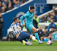 Tottenham Hotspur's Son Heung-Min (right) is tackled by Brighton & Hove Albion's Lewis Dunk (left) <br /> <br /> Photographer David Horton/CameraSport<br /> <br /> The Premier League - Brighton and Hove Albion v Tottenham Hotspur - Saturday 5th October 2019 - The Amex Stadium - Brighton<br /> <br /> World Copyright © 2019 CameraSport. All rights reserved. 43 Linden Ave. Countesthorpe. Leicester. England. LE8 5PG - Tel: +44 (0) 116 277 4147 - admin@camerasport.com - www.camerasport.com