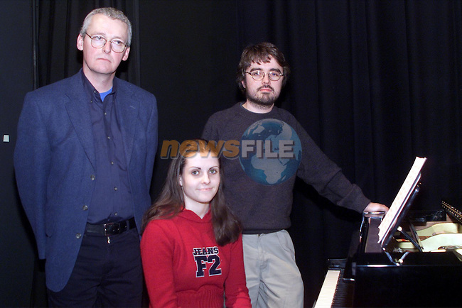 Jenee Owens (ctr), student at Greenhills school pictured with her music teacher, Paul Brennan, left, and David Darcy, educational  officer of the national chamber choir, at the Bus Eireann composition workshop in the Drogheda Arts centre..pic: Newsfile
