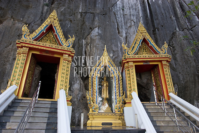 A beautifully decorated entrance to a temple cave (Khao Yoi) in Phetchaburi, Thailand.
