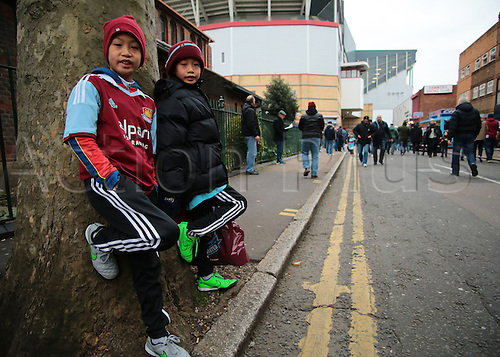 27.02.2016. Boleyn Ground, London, England. Barclays Premier League. West Ham versus Sunderland. Early young West Ham fans waiting for The Boleyn Ground turnstiles to open