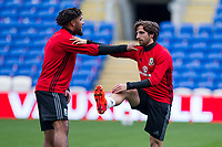 Ashley Williams and Joe Allen stretch during Wales national team training ahead of the World Cup Qualification match against Republic of Ireland at Cardiff City Stadium, Cardiff, Wales on 8 October 2017. Photo by Mark  Hawkins.