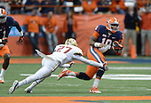 Syracuse Orange quarterback Terrel Hunt (10) avoid the tackle of Justin Simmons (27) during a game against the Boston College Eagles at the Carrier Dome on November 30, 2013 in Syracuse, New York.  Syracuse defeated Boston College 34-31.  (Copyright Mike Janes Photography)
