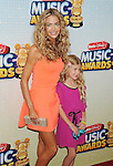 LOS ANGELES, CA- APRIL 27: Actress Denise Richards and daughter Lola Sheen arrive at the 2013 Radio Disney Music Awards at Nokia Theatre L.A. Live on April 27, 2013 in Los Angeles, California.