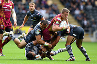 PICTURE BY ALEX WHITEHEAD/SWPIX.COM - Rugby League - Super League - Hull FC v Huddersfield Giants - KC Stadium, Hull, England - 01/07/12 - Huddersfield's Larne Patrick is tackled by Hull's Sam Moa, Willie Manu and Aaron Heremaia.