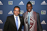 January 17th, 2013: #6 draft pick Deshorn Brown (JAM), selected by the Colorado Rapids, with head coach Oscar Pareja (COL). The 2013 MLS SuperDraft was held during the NSCAA Annual Convention held in Indianapolis, Indiana.
