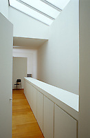The sun floods in from a long skylight on the landing accentuating the feeling of lightness and space