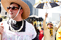 "Thousands of Saints fans wearing dresses paraded from the Louisiana Superdome to the French Quarter on January 31, 2010 in New Orleans to honor a promise made by the late sportscaster and Saints super-fan Buddy Diliberto aka ""Buddy D"".<br /> <br /> In 1993 Buddy D, who passed away in 2005, remarked on air that if the Saints were to make it to the Super Bowl, he would wear a dress and dance down the streets.  The comment was repeated at various times and never forgotten by his listeners.<br /> <br /> Led by former New Orleans Saints quarterback Bobby Hebert, who has taken Buddy D's place on WWL radio, thousands made good on his promise for him, dancing, drinking, and cavorting their way down the street, alternately yelling out ""Who Dat!"" and ""Buddy D!"" in front of an onlooking crowd an estimated 85,000 people strong.<br /> <br /> The hard luck NFL team the New Orleans Saints has reached its first Super Bowl in team history, after 43 years largely filled with losing seasons and futility.  It is difficult to travel anywhere in the area without some reminder of this fact, as the team and city are intertwined perhaps like no other sports franchise in this country."
