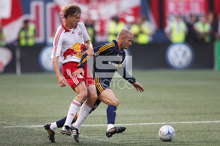 Los Angeles Galaxy midfielder David Beckham (23) and New York Red Bulls defender Dave van den Bergh (11). The New York Red Bulls and the Los Angeles Galaxy played to a 2-2 tie during a Major League Soccer match at Giants Stadium in East Rutherford, NJ, on July 19, 2008.