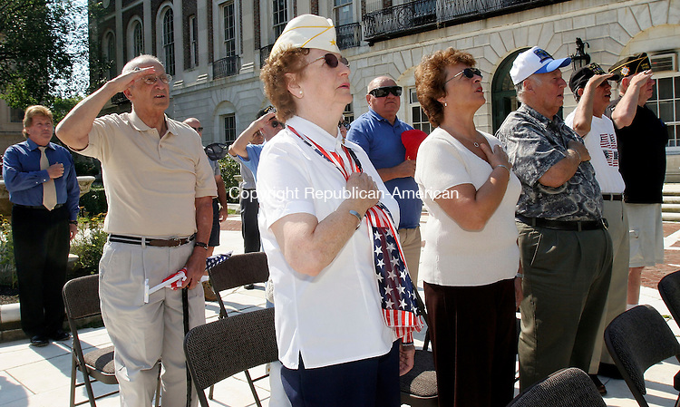 WATERBURY, CT-14August 2006-081406TK06- Mary Knight(center), Gold Star Mother, President Department of Connecticut along with along with area veterans participate in the recitation in the Pledge of Allegiance during the VJ Day ceremonies. Tom Kabelka Republican-American (Mary Knight)