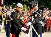 Britain's Prince Harry, left, and Army Sgt. 1st Class Tanner Welch, Sergeant of the Guard, Tomb of the Unknown Soldier, 3rd U.S. Infantry Regiment (The Old Guard), place a wreath at the Tomb of the Unknowns at Arlington National Cemetery on May 10, 2013..Mandatory Credit: Luisito Brooks / DoD via CNP