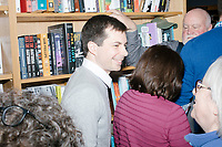 Democratic presidential candidate Pete Buttigieg greets people after speaking at a campaign event at Gibson's Bookstore in Concord, New Hampshire, USA, on Sat., Apr. 6, 2019. Buttigieg is the mayor of South Bend, Indiana, and was widely considered a long-shot candidate until his appearance in a CNN town hall in March 2019 which catapulted his campaign to prominence and substantial donations. Buttigieg stood on a chair throughout the speech in the crowded shop.