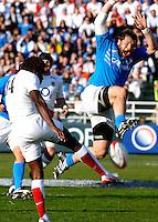 Photo: Omega/Richard Lane Photography. Italy v England. RBBS Six Nations. 10/02/2008. England's Paul Sackey kicks clear as Italy's Martin Castrogiovanni charges down.