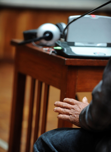 Witness Marcos Bop Sanchez show his emotion with hands during his testimony during the second day of trial of former Guatemalan dictator, Efrain Rios Montt in the Supreme Court of Justice Guatemala CIty March 20, 2013.