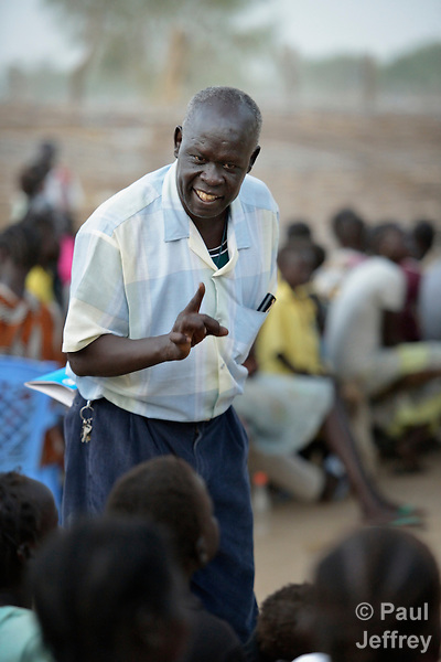A man teaches a Roman Catholic catechism class in Agok, a town in the contested Abyei region where tens of thousands of people fled in 2011 after an attack by soldiers and militias from the northern Republic of Sudan on most parts of Abyei. Although the 2005 Comprehensive Peace Agreement called for residents of Abyei--which sits on the border between Sudan and South Sudan--to hold a referendum on whether they wanted to align with the north or the newly independent South Sudan, the government in Khartoum and northern-backed Misseriya nomads, excluded from voting as they only live part of the year in Abyei, blocked the vote and attacked the majority Dinka Ngok population. The African Union has proposed a new peace plan, including a referendum to be held in October 2013, but it has been rejected by the Misseriya and Khartoum. The Catholic parish of Abyei, with support from Caritas South Sudan and other international church partners, has maintained its pastoral presence among the displaced and assisted them with food, shelter, and other relief supplies