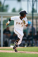 GCL Pirates shortstop Adrian Valerio (57) runs to first during the first game of a doubleheader against the GCL Yankees 2 on July 31, 2015 at the Pirate City in Bradenton, Florida.  GCL Pirates defeated the GCL Yankees 2 2-1.  (Mike Janes/Four Seam Images)