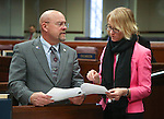 Nevada Assemblyman Ira Hansen, R-Sparks, talks with policy analyst Diane Thornton on the Assembly floor at the Legislative Building in Carson City, Nev., on Tuesday, April 14, 2015. <br /> Photo by Cathleen Allison