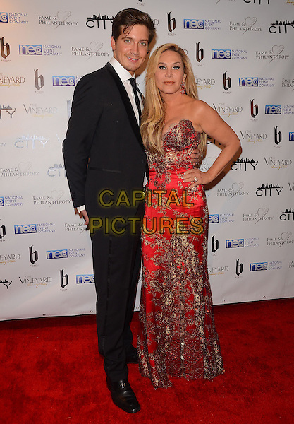 02 March 2014 - Beverly Hills, California - Jacob Busch, Adrienne Maloof.  Fame and Philanthropy Post-Oscar Gala celebrating the 86th Annual Academy Awards held at The Vineyard Beverly Hills. <br /> CAP/ADM/BT<br /> &copy;Birdie Thompson/AdMedia/Capital Pictures