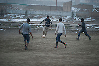 Afghan boys playing football near the Darulaman Palace in Kabul. 2-1-14