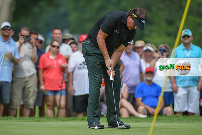 Phil Mickelson (USA) sinks his birdie putt on 2 during 4th round of the World Golf Championships - Bridgestone Invitational, at the Firestone Country Club, Akron, Ohio. 8/5/2018.<br /> Picture: Golffile | Ken Murray<br /> <br /> <br /> All photo usage must carry mandatory copyright credit (© Golffile | Ken Murray)