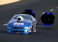 Jul. 19, 2014; Morrison, CO, USA; NHRA pro stock driver Larry Morgan during qualifying for the Mile High Nationals at Bandimere Speedway. Mandatory Credit: Mark J. Rebilas-