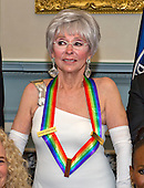 Singer Rita Moreno, one of the five recipients of the 38th Annual Kennedy Center Honors, poses as part of a group photo following a dinner hosted by United States Secretary of State John F. Kerry in their honor at the U.S. Department of State in Washington, D.C. on Saturday, December 5, 2015.  The 2015 honorees are: singer-songwriter Carole King, filmmaker George Lucas, actress and singer Rita Moreno, conductor Seiji Ozawa, and actress and Broadway star Cicely Tyson.<br /> Credit: Ron Sachs / Pool via CNP