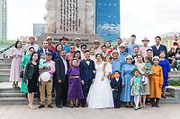 Mongolia, Ulaanbaatar. Sukhbaatar Square, family wedding photo.