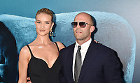 HOLLYWOOD, CA - AUGUST 06: Rosie Huntington-Whiteley (L) and Jason Statham attend the premiere of Warner Bros. Pictures and Gravity Pictures' Premiere of 'The Meg' at the TLC Chinese Theatre on August 06, 2018 in Hollywood, California.<br /> CAP/ROT/TM<br /> &copy;TM/ROT/Capital Pictures