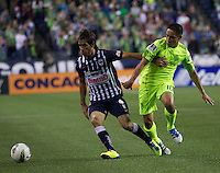 César Delgado, left, of CF Monterrey battles David Estrada of the Seattle Sounders FC during a CONCACAF Champions League match at CenturyLink Field in Seattle Tuesday Oct. 18, 2011. CF Monterrey won the game 2-1.