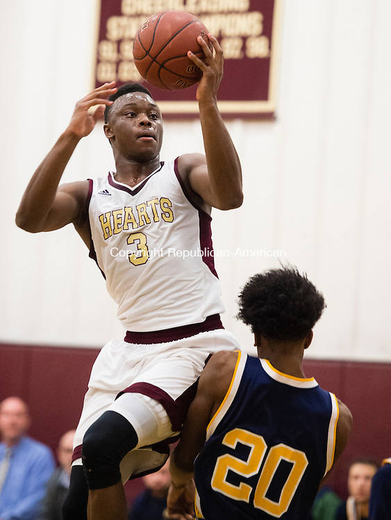 WATERBURY, CT- 8 January 2015-010816EC10-    Sacred Heart's Mustapha Heron glides to the net over Kennedy's Jameel Brooks-Norwood Friday night. The Hearts defeated the Eagles in front of a sold-out crowd, 96-49. Erin Covey Republican-American