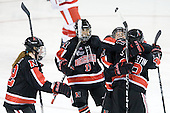 Maggie Brennolt (NU - 22), Rachel Llanes (NU - 11), Claire Santostefano (NU - 13) and Sonia St. Martin (NU - 12) celebrate St. Martin's goal. - The Northeastern University Huskies tied Boston University Terriers 3-3 in the 2011 Beanpot consolation game on Tuesday, February 15, 2011, at Conte Forum in Chestnut Hill, Massachusetts.