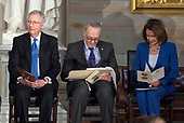 From left to right: United States Senate Majority Leader Mitch McConnell (Republican of Kentucky), US Senate Minority Leader Chuck Schumer (Democrat of New York) and US House Minority Leader Nancy Pelosi (Democrat of California) listen to remarks at a Congressional Gold Medal ceremony honoring former US Senator Bob Dole (Republican of Kansas) that was also attended by US President Donald J. Trump in the Rotunda of the US Capitol on Wednesday, January 17, 2017.  Congress commissioned gold medals as its highest expression of national appreciation for distinguished achievements and contributions.  Dole served in Congress from 1961 through 1996, was the Senate GOP leader from 1985 through 1996, and was the 1996 Republican Party nominee for President of the United States.<br /> Credit: Ron Sachs / CNP