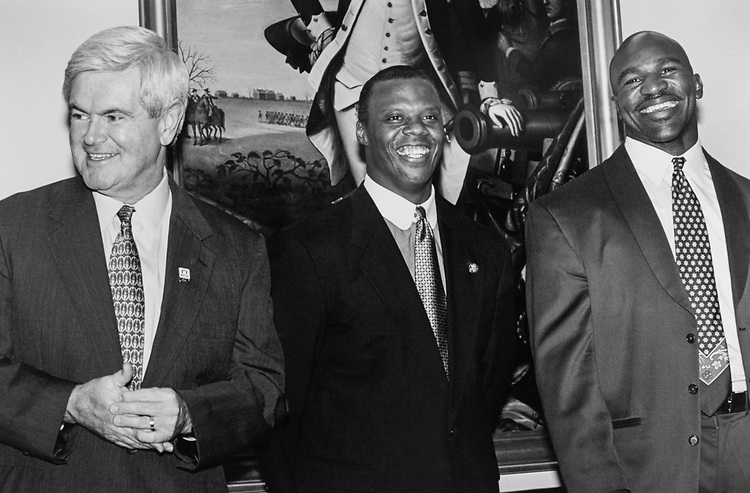 Boxer Evander Holyfield, on Capitol Hill had been testifying on behalf of 'fatherhood.' Here with Speaker of the House Rep. Newt Gingrich, R-Ga., and Rep. J. C. Watts, R-Okla., on July 24, 1997. (Photo by Maureen Keating/CQ Roll Call via Getty Images)